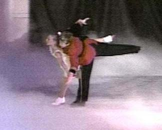 Claire and the Prince skating as a pair in a camel position