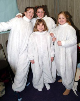 four skaters posing in their rat suits