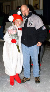 A rat skater holding her flowers standing with her dad