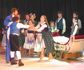 Clara and Fritz fight over the doll while a group of children stand behind and watch.  An adult skater is close to Clara and Fritz.