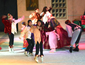 A group of jesters skating with children from the party