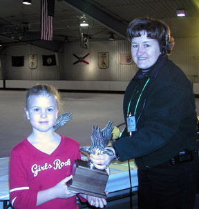 Shawnda and skater hold the first place trophy